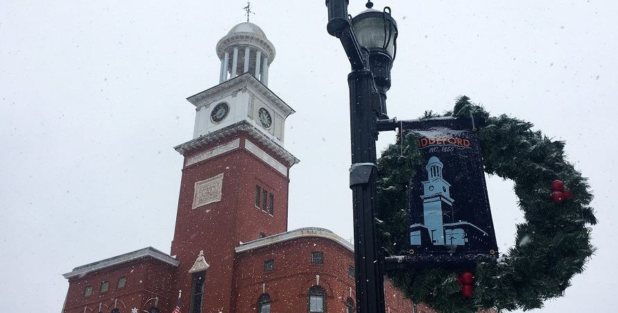 The City Hall clock tower during snowfall